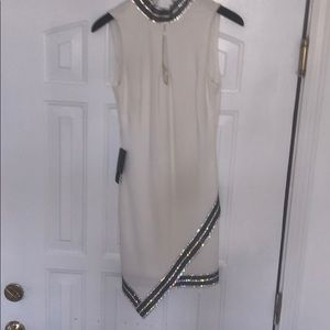 Bebe beaded asymmetrical dress NWT. Stunner!!!